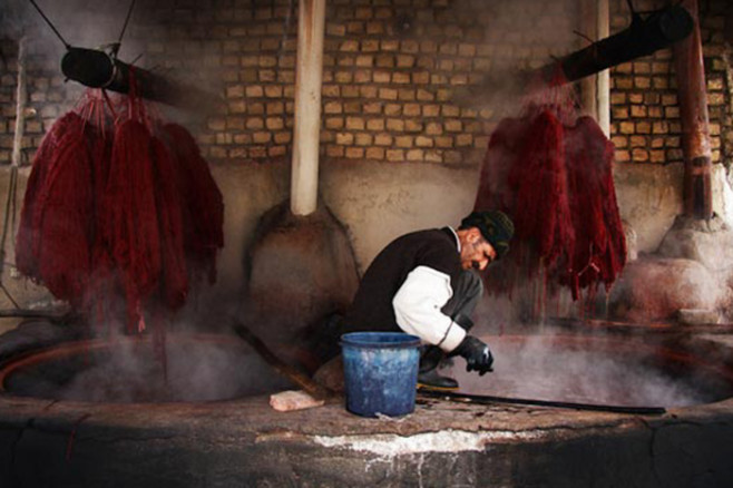 man dyeing wool